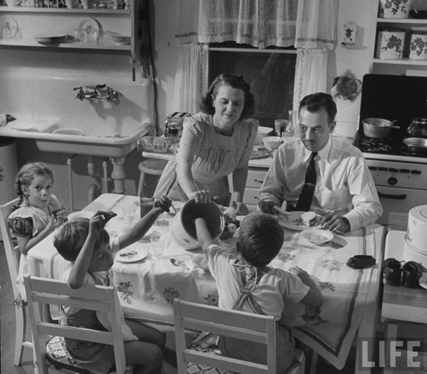 1940s housewife serves lunch.jpg