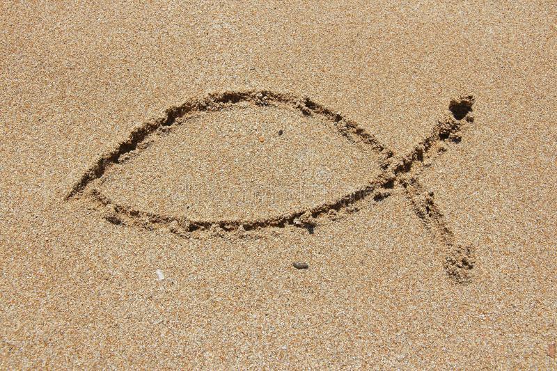 christianity-fish-symbol-religious-shape-drawn-sand-catholicism-ichthus-48937659.jpg